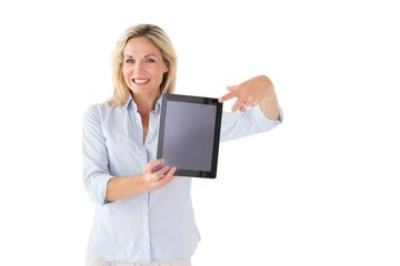 Happy blonde pointing to her tablet pc screen
