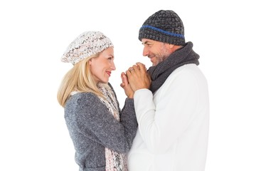 Couple in winter fashion embracing