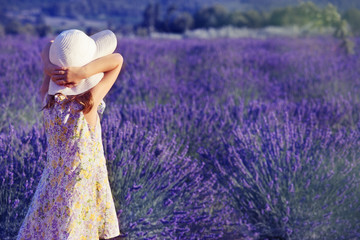 Little girl looking at the lavender field