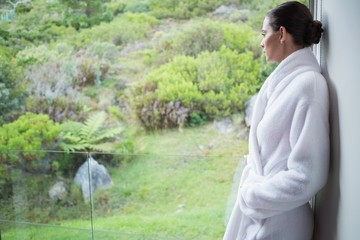 Relaxed woman wearing a bathrobe