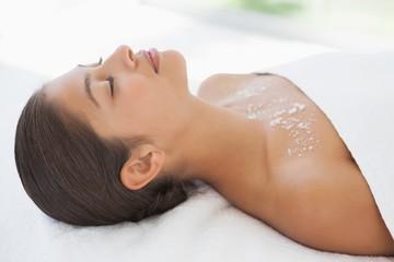 Beautiful brunette lying on massage table