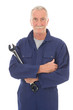 man in blue overall with wrench