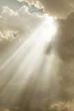 Cross appears in the sky with rays of light