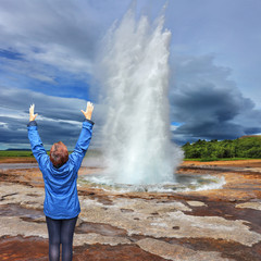 Woman - turist delighted geyser