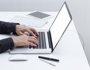 Man hands typing laptop computer keyboard