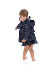 little girl in a polka dot raincoat isolate