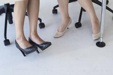 Feet of woman sitting
