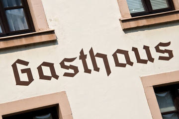 Gasthaus sign on a wall, meaning restaurant in German