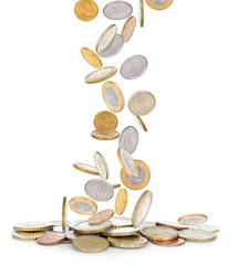 Heap of coins falling to the ground