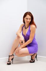 Pretty woman squatting
