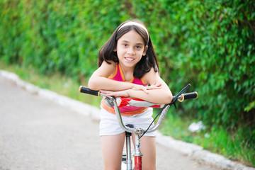 Cute hicpanic girl on bicycle