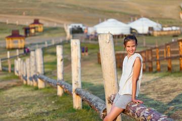 Girl against rural view