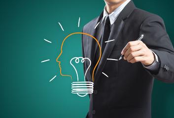 Business man drawing light bulb metaphor, Inspiration concept