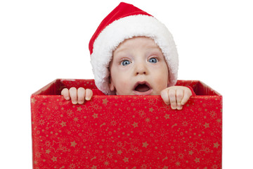 Christmas baby in red gift box