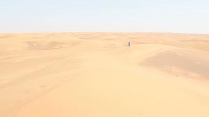 young woman jogging through the desert