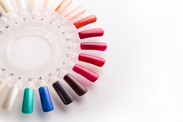 Manicure nail polish color samples. on white background
