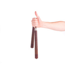 Hand holding nunchaku weapon.