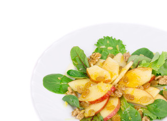 Healthy salad with apple and walnuts.
