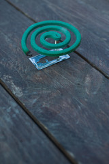 Mosquito coil on the wood