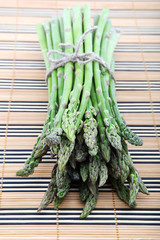 Fresh green asparagus on a wooden table.