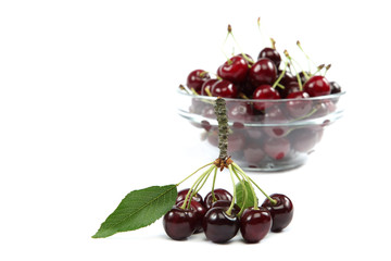 Fresh cherries isolated on a white background.
