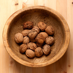 Walnuts in vintage wooden bowl