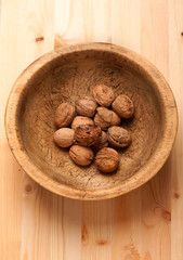 Walnuts in old wooden bowl