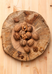 Walnuts on wooden board