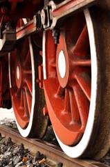 fresh painted train wheels on rails