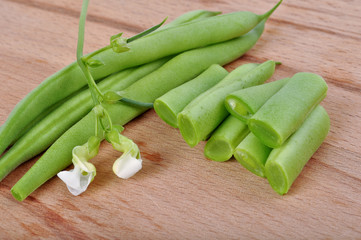 Green beans on wooden background