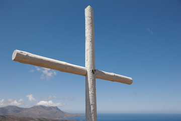 Wooden cross in a cretan graveyard. Greece