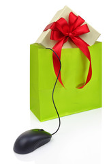 Gift box in a shopping bag connected to a computer mouse
