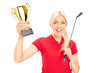 Female golfing champion holding a trophy