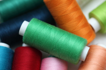 Colorful spools of sewing threads