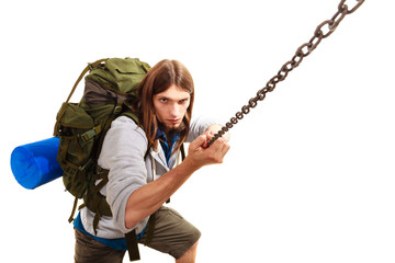 male hiker with backpack climbing isolated