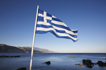 Cretan landscape with greek flag and the Lybian sea