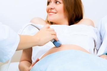 hands and abdominal ultrasound scanner