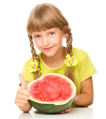 Little girl is eating watermelon