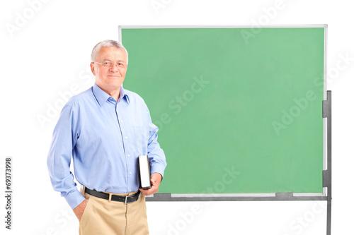 Mature school teacher holding a book