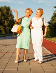 Two senior women walking outside