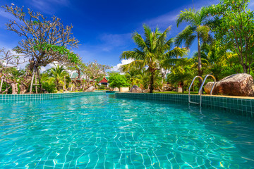 Tropical holidays at swimming pool in Thailand