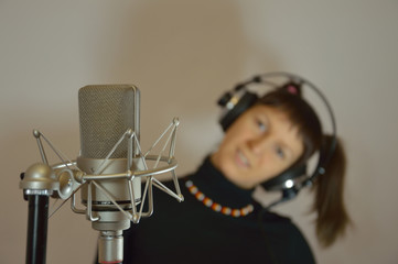 The girl in earphones and microphone