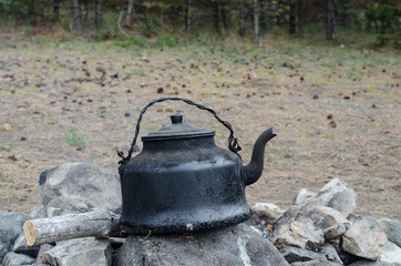 sooty kettle on the fire