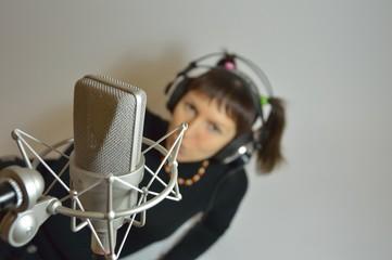 Girl, headphones, microphone