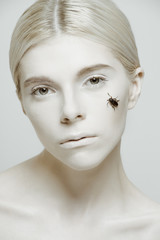 Beauty Portrait of model with insect on her face