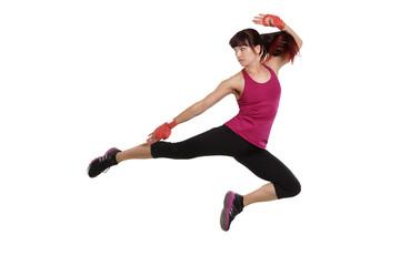 Frau beim Kampfsport - Sprung