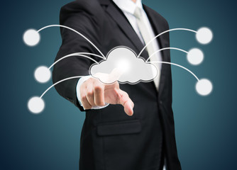 Businessman hand pressing cloud icon on concept for cloud comput
