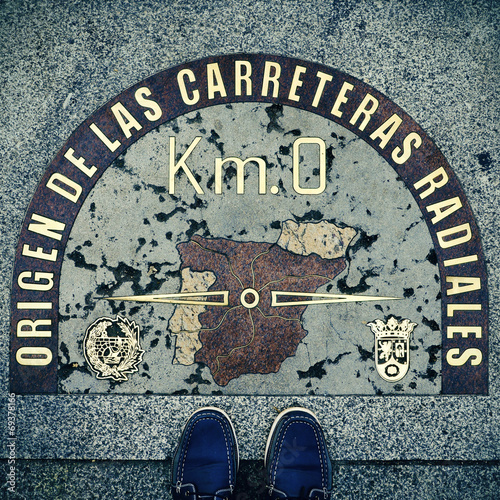 Fotobehang Madrid Kilometre Zero point in Puerta del Sol, Madrid, Spain, with a re
