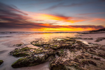 beautiful beach rock under sunset