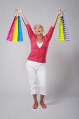 Senior woman is very happy from shopping